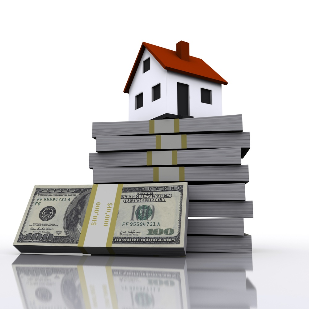 A small cottage and a three-dimensional stack of hundred-dollar bills. symbol of a successful real estate business